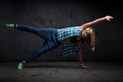 Modern dancer. Poses in front of the grungy concrete wall background stock images