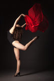 Modern dancer with red fabric posing on grey Royalty Free Stock Images