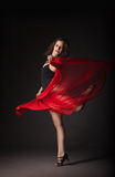Modern dancer with red fabric posing on grey Royalty Free Stock Image