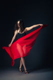 Modern dancer with red fabric posing on grey Royalty Free Stock Photography