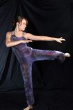 Modern dancer in standing pose. A modern dancer poses standing on one leg Stock Photo