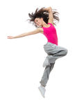 Modern dancer style teenage girl jumping dancing. New pretty modern slim hip-hop style dancer teenage girl jumping dancing isolated on a white studio background stock photography