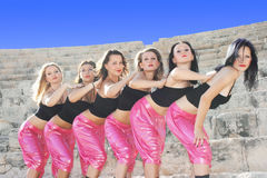 Modern dancers. Beautiful modern dancers on the ancient stairs of  Kurion amphitheatre in Cyprus Royalty Free Stock Photos