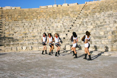 Modern dancers. Beautiful modern dancers on the ancient stairs of  Kourion amphitheatre in Cyprus Stock Image