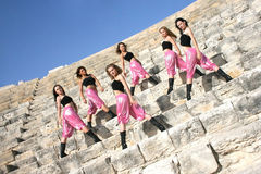 Modern dancers. Beautiful modern dancers on the ancient stairs of  Kurion amphitheatre in Cyprus Royalty Free Stock Images