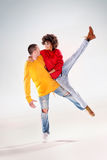 Modern dancers in studio. Young girl with afro dancing with boy, modern dancers Stock Photo