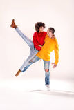 Modern dancers in studio. Young girl with afro dancing with boy, modern dancers Royalty Free Stock Photo