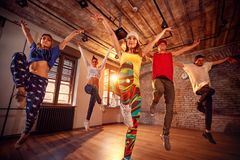 Modern dancing group practice dancing in jump. Sport, dancing an royalty free stock image