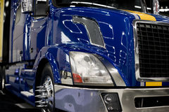 Modern dark blue custom semi truck tractor with lot of light ref Royalty Free Stock Images