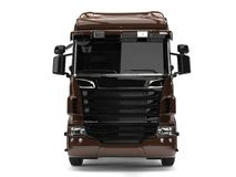 Modern dark brown heavy transport truck without a trailer. Front view Royalty Free Stock Photography