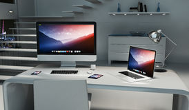 Modern dark desk office interior with computer and devices 3D re Royalty Free Stock Photos