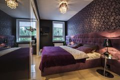 Modern, dark interior design. Bedroom with king size bed Royalty Free Stock Photography