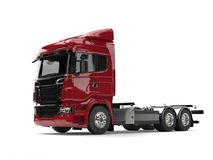 Modern dark red heavy transport truck without a trailer Royalty Free Stock Photo