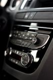 Modern dashboard with clima controls in car interior. Modern dashboard with clima and audio controls in a car interior Stock Photography