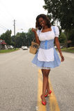 Modern Day Dorothy, full color. Modern Day Dorothy walking down the yellow lined road Stock Images