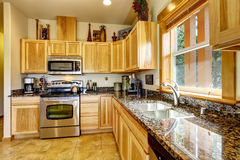 Modern day kitchen with tile floor. Stock Images