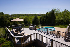 Modern deck and swimming pool Royalty Free Stock Photos