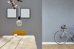 Modern decoration in vintage loft branch lamp table and silver bike Royalty Free Stock Image