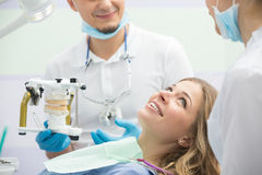 Modern dental clinic, young dentist working Stock Photo