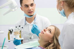 Modern dental clinic, young dentist working Stock Images