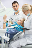 Modern dental clinic, young dentist working Stock Photography