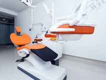 Modern dental room. On orange color stock photography