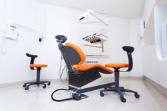 Modern dental room. On orange color royalty free stock photography
