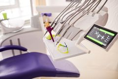 Close-up Shot of Dentistry Equipment. Modern dentistry equipment and cozy purple chair at dental room, close-up shot stock photos