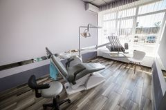 Modern dentistry office interior with chair and tools - medicine Royalty Free Stock Photo