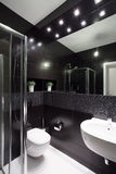 Modern design of bathroom. Modern design of small bathroom with black tiles royalty free stock photos