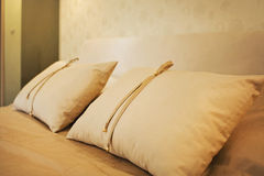 Modern design. Beautiful modern pillows laying on bed Royalty Free Stock Photography