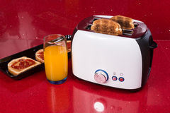 Modern design of the bread toaster in the  red kitchen interior Royalty Free Stock Photography