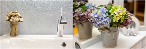 Modern design of chrome faucet with flowers Royalty Free Stock Photo