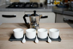 Modern design coffee cups and vintage coffeepot.  Stock Image