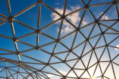 Modern design curved steel frame structure under a blue sky. Modern design curved steel metal frame structure under a blue sky stock images