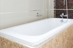 Bathroom bathtub. Modern design home blur bathroom bathtub White sanitary ware in the bathroom Stock Photo