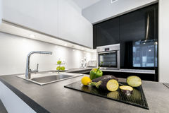 Modern design kitchen in black and white style. Modern design kitchen with electric appliances and stone worktop Royalty Free Stock Images