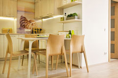 Modern design. Modern kitchen design with chairs and table Royalty Free Stock Photo