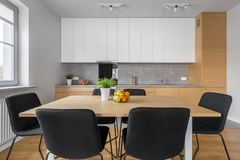 Modern kitchen with wooden table royalty free stock photography