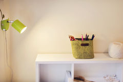 Modern design. Pencils on a table under lamp light Royalty Free Stock Photography