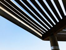 Modern design pergola arbor made wood with clear blue summer sky.  Stock Image
