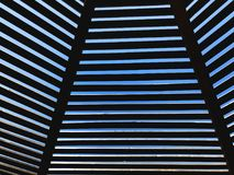 Modern design pergola arbor made wood with clear blue summer sky.  Royalty Free Stock Photography