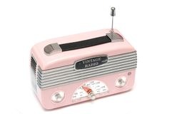 A modern design pink radio of the nostalgic era. A side facing photo taken on a modern design pink radio of the nostalgic era against a white backdrop royalty free stock photos