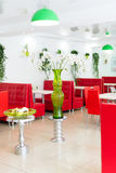 Modern design restaurant interior in white and red colors with plants. Stock Images