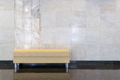 Modern Design Sofa and Marble Wall Royalty Free Stock Photos