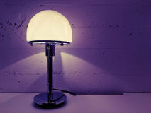 Modern design table lamp near concrete wall Royalty Free Stock Images