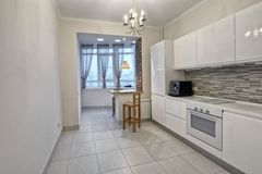 Modern design white kitchen in a spacious apartment. Russia Moscow - Modern interior kitchen design of urban real estate Stock Image