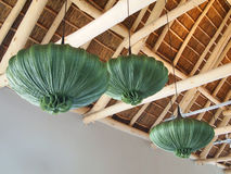 Modern design wooden ceiling. Green chandeliers in the shape of Stock Photography