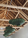 Modern design wooden ceiling. Green chandeliers in the shape of. Modern design wooden ceiling with exposed beams. Green lights in the original performance royalty free stock images