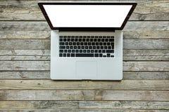 Modern designed laptop on old wooden desk Stock Photography